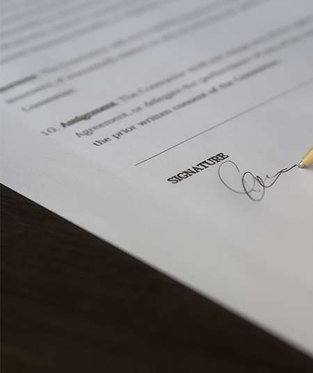 Document being signed - contract litigation law.